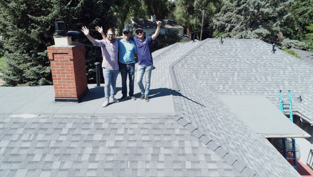 Summit Roofing Solutions team on roof